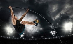 Professional pole vaulter training at the stadium in the evening. Sports banner. Horizontal copy space background