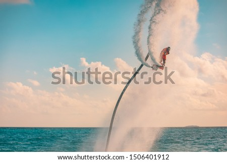 Professional pro fly board rider in tropical sea, water sports concept background. Summer vacation fun outdoor sport and recreation #1506401912