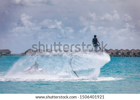 Professional pro fly board rider in tropical sea, water sports concept background. Summer vacation fun outdoor sport and recreation #1506401921