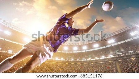 Professional rugby player jumps with a ball on a professional sports arena with bleaches full of people. Arena and people on it are made in 3D.  #685151176