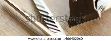 Professional Scissors and Razor of Barbershop. Vintage Shaver and Cutting Tool on Wooden Background. Hairdresser Instrument for Shaving Closeup. Hairstyling Accessory Partial View Photography