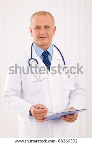 Professional senior doctor male with stethoscope portrait write document folders