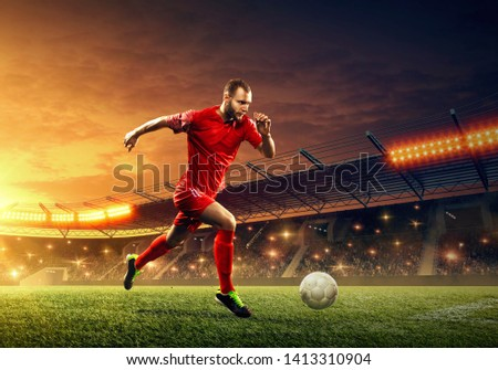 Professional soccer player on soccer arena in action. Night stadium
