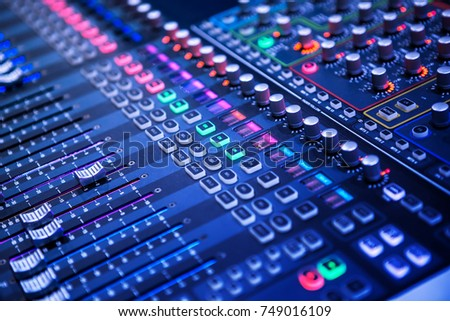 Professional sound and audio mixer control panel with buttons and sliders