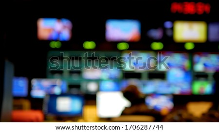 Professional sound engineer's console. Television Broadcast, working with video and audio mixer, control broadcast in recording studio. blurred background, monitors. Stock photo ©