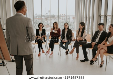 professional speaker or a business speaker. professional speaker or a business speaker. Business trainer giving presentation to group of people. #1191687385