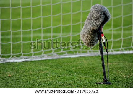 86901e502 Professional sport microphone on a soccer field behind the net #319035728 ·  Big and furry ...