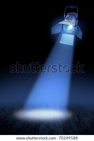 Professional stage spotlight lamp beam  glowing on dark background