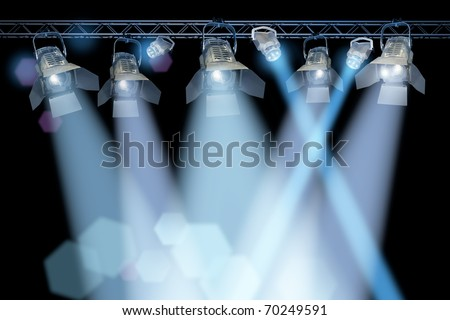 Professional stage spotlight lamps rack on black background