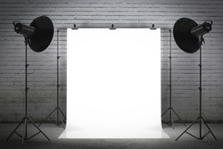 Professional strobe lights illuminating a backdrop
