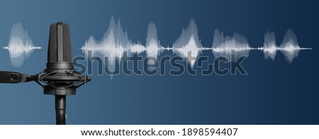 Professional studio microphone recording voice with audio waveform signal, dark blue background, recording studio, broadcasting or podcasting banner with copy space