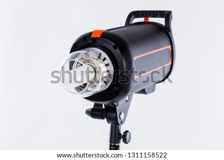Professional studio strobe photo flash light. Digital LED display photography studio flash strobe lighting head. Lighting studio equipment for photography.