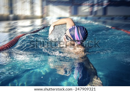 Professional swimmer crawl freestyle in a swimming pool