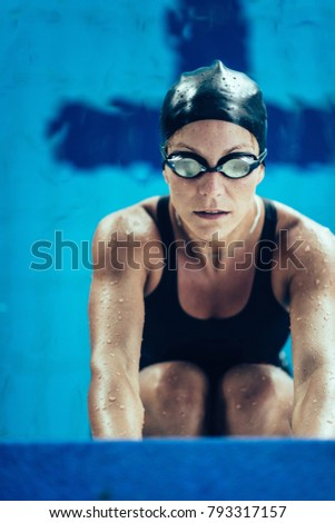 Professional swimmer in training, indoor swimming pool #793317157