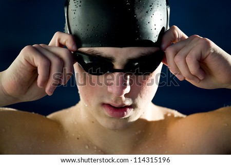 professional swimmer portrait isoalted blue background