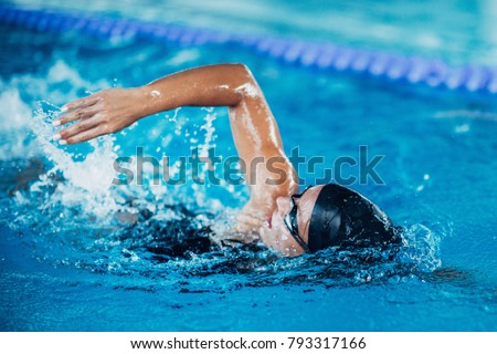Photo of  Professional swimmer, swimming race, indoor pool