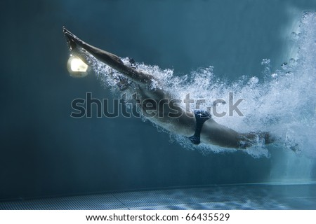 professional swimmer underwater after the jump