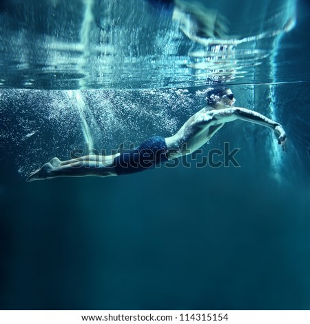 professional swimmer underwater swimming Butterfly #114315154
