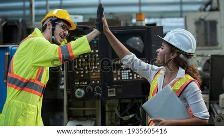Professional  team engineering Man Worker at industrial factory wearing uniform and hardhats at Metal lathe industrial manufacturing factory. Engineer Operating lathe Machinery