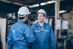 professional technician engineer and mentor shake hand in factory