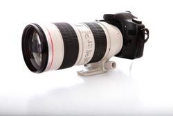 Professional telephoto lens and digital camera body.
