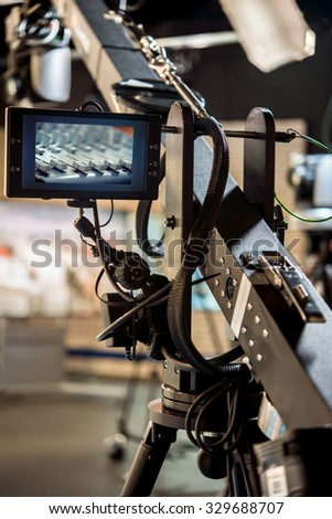 Professional Tripod Crane screen display on a television studio