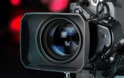 Professional video camera on dark background