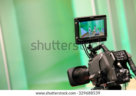 Professional video camera with display in a television studio