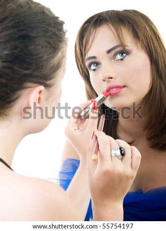professional visage artist applying makeup to a model