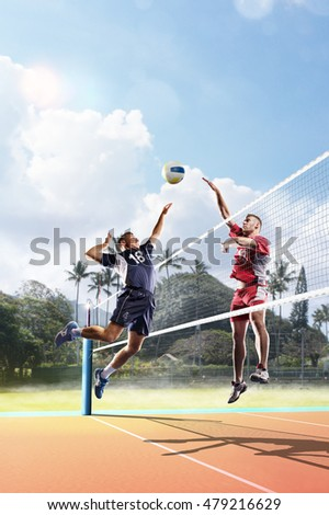 Professional volleyball players in action on the court