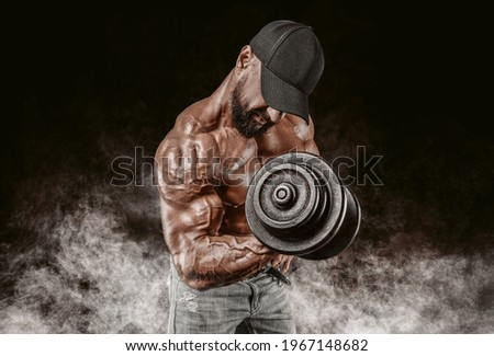 Professional weightlifter is training in the gym. Dumbbell Curl. Bodybuilding concept. Mixed media Photo stock ©