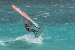 Professional windsurfer jumping in the waves