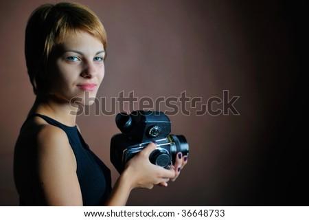 professional woman photographer in studio
