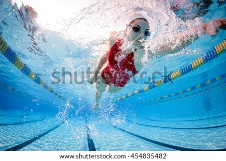 Professional woman swimmer inside swimming pool. #454835482