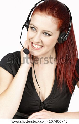 Professional woman talking on a headset in her office at work. With white background