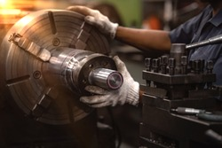 Professional workers are doing the milling process for metal parts, metal machinery in large industrial plants-image