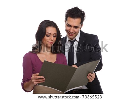 Professional workers looking at a document isolated on white