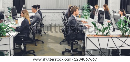 professional young business people working with desktop computers in open space office
