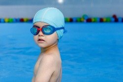professional young swimmer in blue cap ready to swims in pool wather