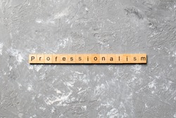 Professionalism word written on wood block. Professionalism text on cement table for your desing, concept.
