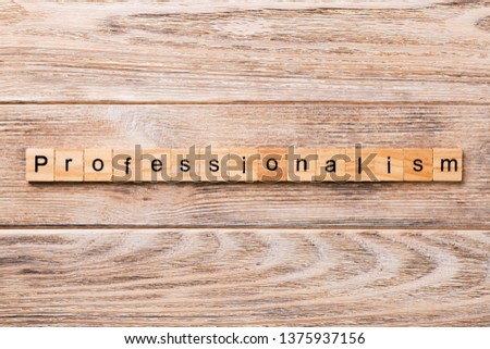 Professionalism word written on wood block. Professionalism text on wooden table for your desing, concept.