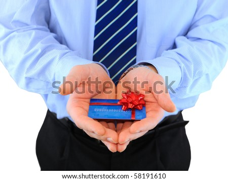 Professionally dressed businessman is giving a present credit car