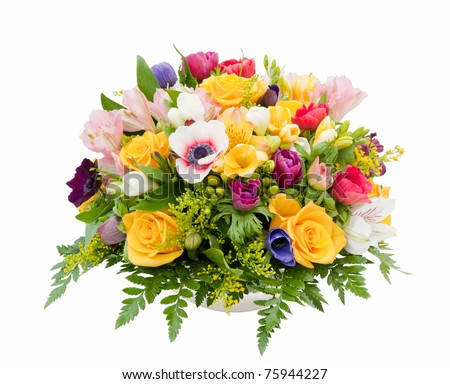 Professionally prepared decorative spring flower arrangement against white background