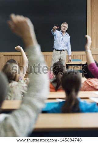 Professor picking out student for an answer in lecture room