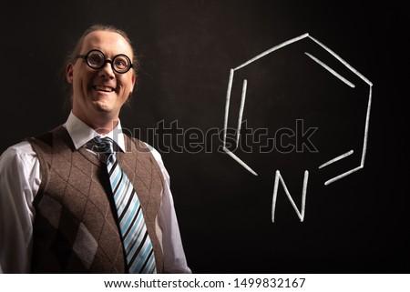 Professor presenting handdrawn chemical formula of Pyridine formula