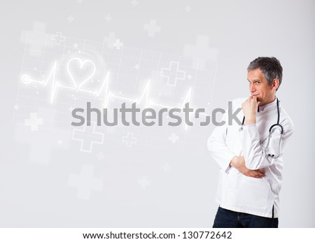 Proffesional doctor examinates heartbeat with abstract heart - stock photo