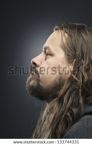 Profile Of A Bearded Long Haired Man