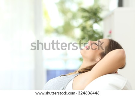 Shutterstock Profile of a beautiful woman relaxing lying on a couch at home