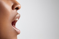 profile of a black woman with open mouth