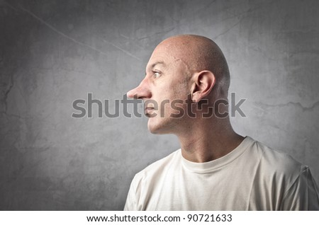 Profile of a lying man with long nose - stock photo